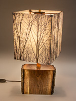 118: Table lamp with Indiana walnut log base and photo silk shade with image of walnut trees in winter.