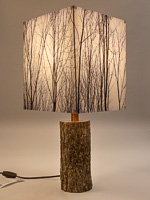125: Table lamp with Indiana walnut log base and photo silk shade with image of walnut trees in winter.