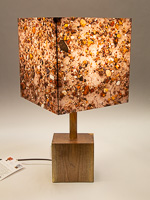 132: Table lamp with black walnut base and photo silk shade with image of petrified wood pebbles.