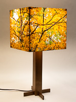 154: Table lamp with walnut hardwood base and photo silk shade with image of maple tree in fall.