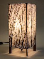 159: Table lamp with tall basic walnut base and photo silk shade with image of tops of walnut trees.