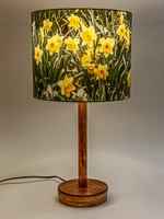 175: Table lamp with ceramic base and photo silk shade with image of daffodils.