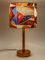 176: Table lamp with ceramic base and photo silk shade with image of a Smithsonian quilt.