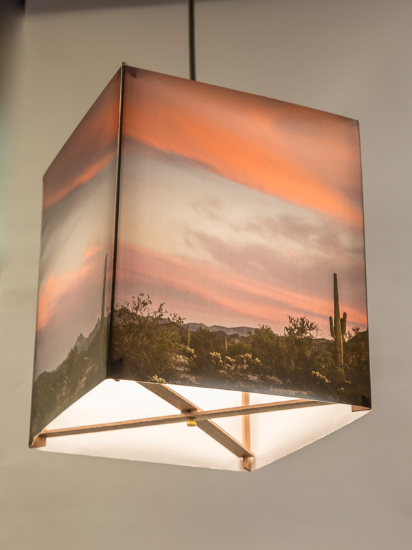 Hanging lamp with image of Arizona desert at sunset.
