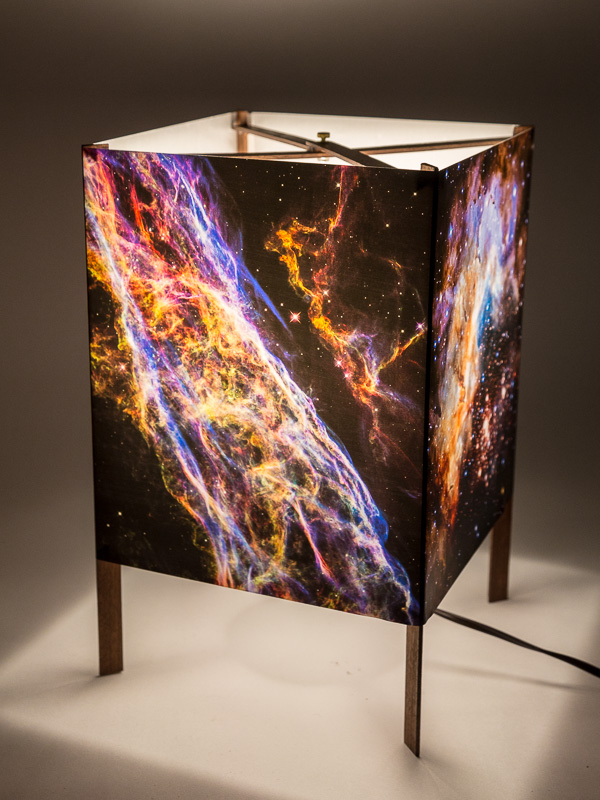 Table lamp of  photo silk  with NASA Hubble images of galaxies.