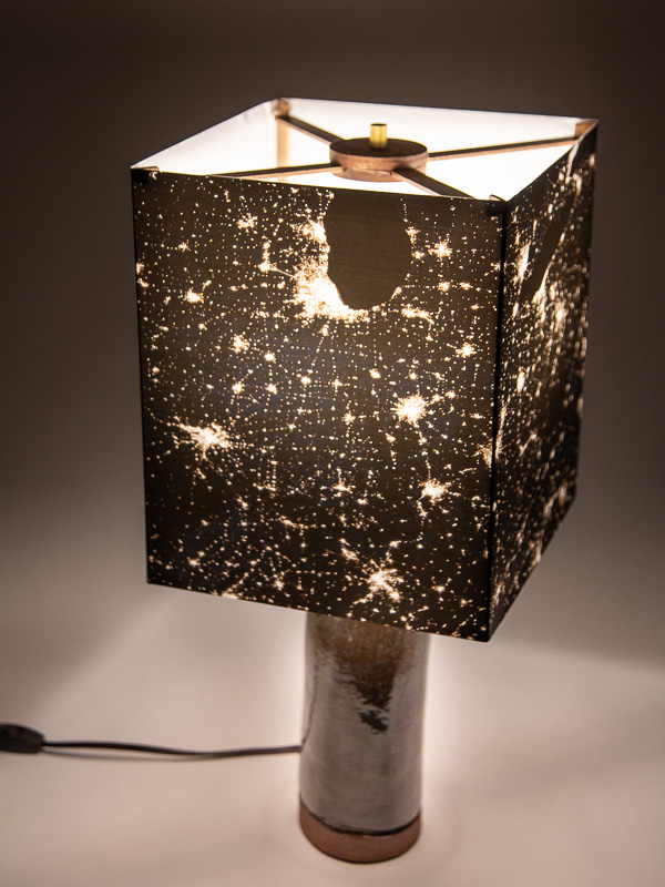 Table lamp with ceramic base and photo silk shade with NASA image of Eastern USA at night.