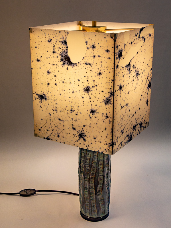 Table lamp with ceramic base and photo silk shade with NASA negative image of Eastern USA at night