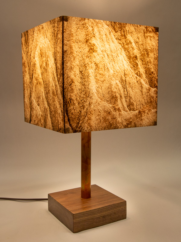 Table lamp with walnut hardwood base and photo silk shade with image of badlands in Arizona.