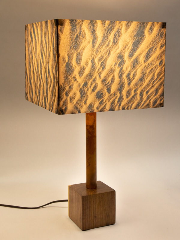 Table lamp with Indiana walnut cube base and photo silk shade with image of sand ripples in Death Valley dunes.