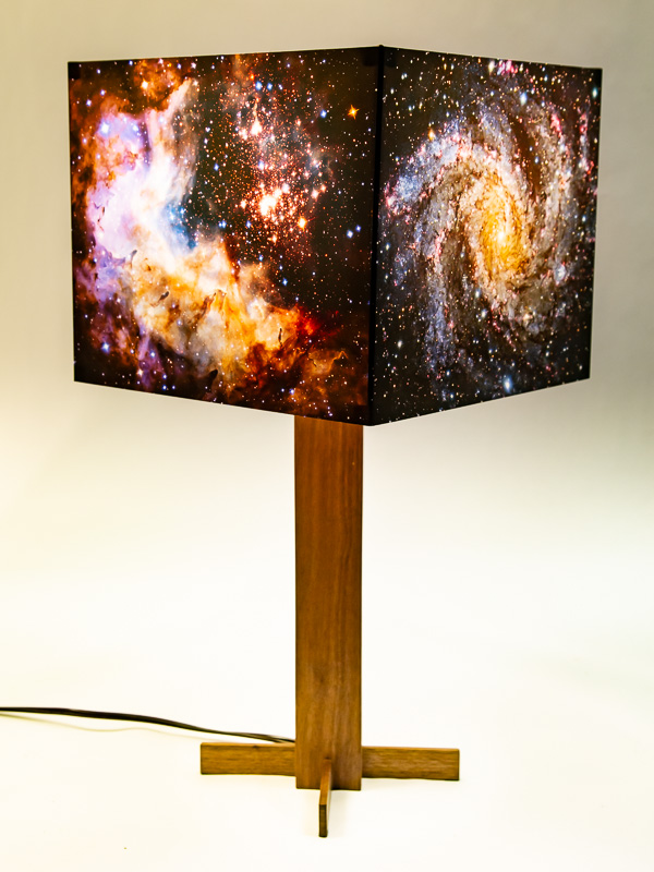 Table lamp with black walnut base and photo silk shade with NASA Hubble images of galaxies.