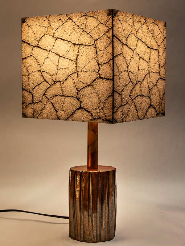 Table lamp with ceramic base and photo silk shade with image of Death Valley cracked mud.