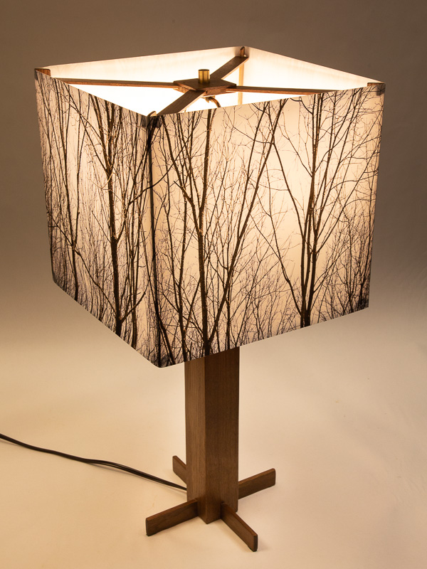 Table lamp with Indiana walnut base and photo silk shade with image of walnut trees in winter.