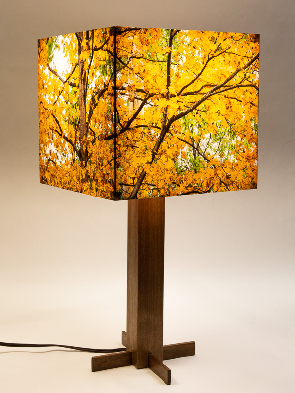 Table lamp with walnut hardwood base and photo silk shade with image of maple tree in fall.