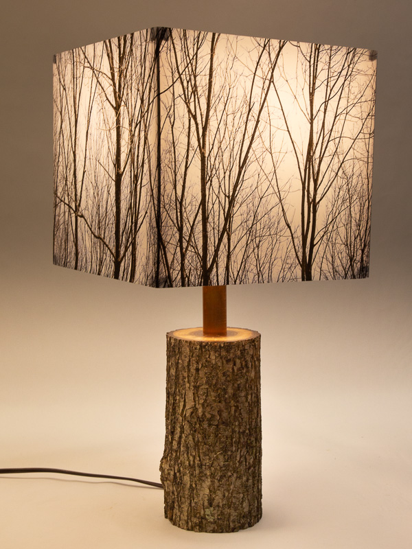 Table lamp with Indiana walnut log base and photo silk shade with image of walnut trees in winter.
