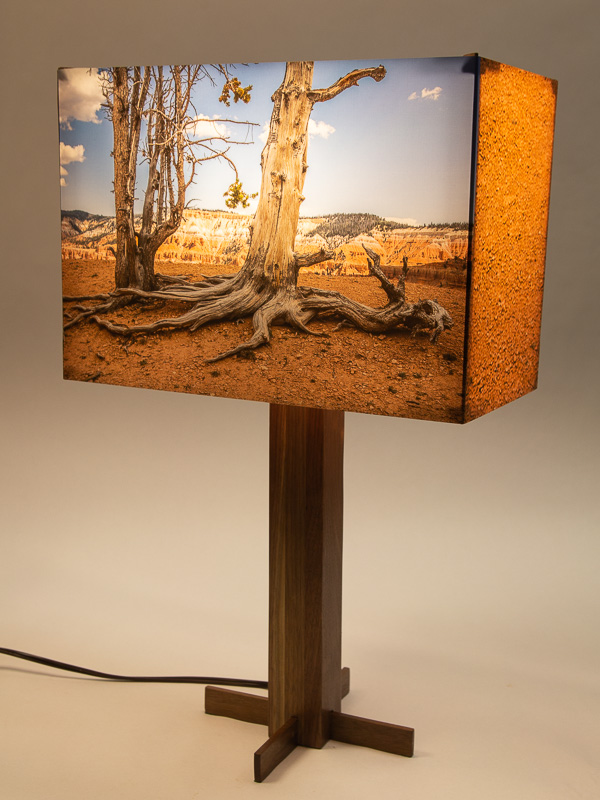 Table lamp with black walnut base and photo silk shade with a landscape photo of Bristlecone Pine trees.