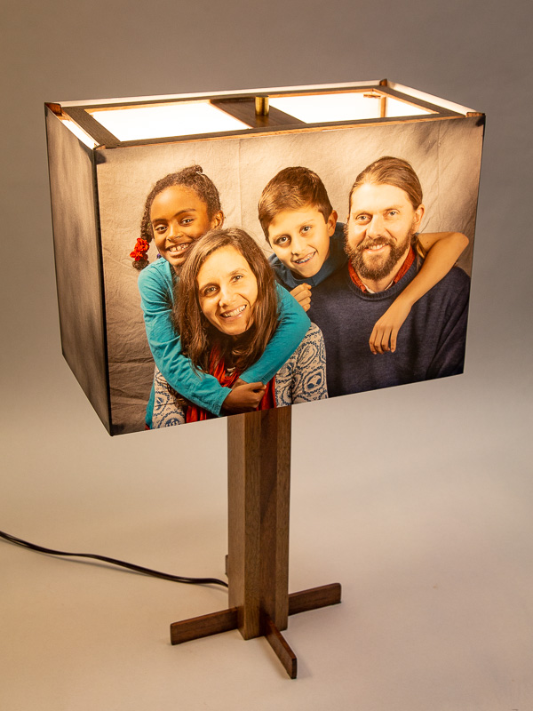 Table lamp with black walnut base and photo silk shade with a custom family photo.