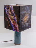 Custom table lamp with ceramic base and astronomy images from the NASA Hubble telescope.