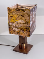 Custom table lamp made from solid walnut with a shade printed with images of petrified wood.